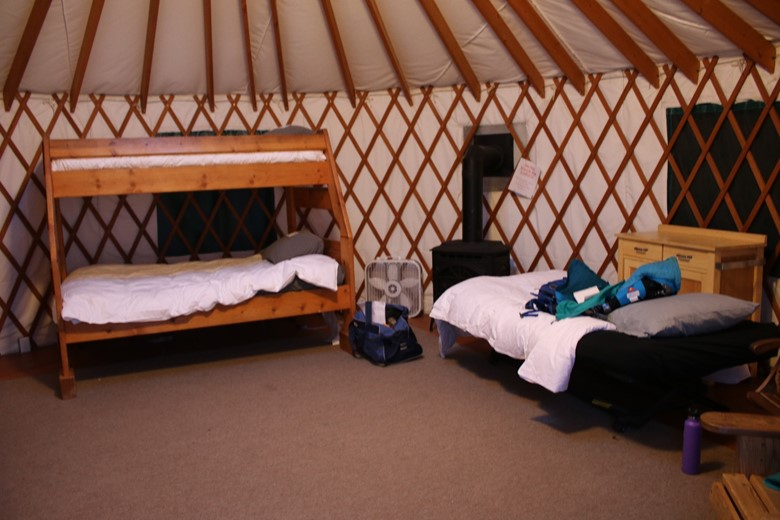 down pillows and spreads are a must for winter glamping