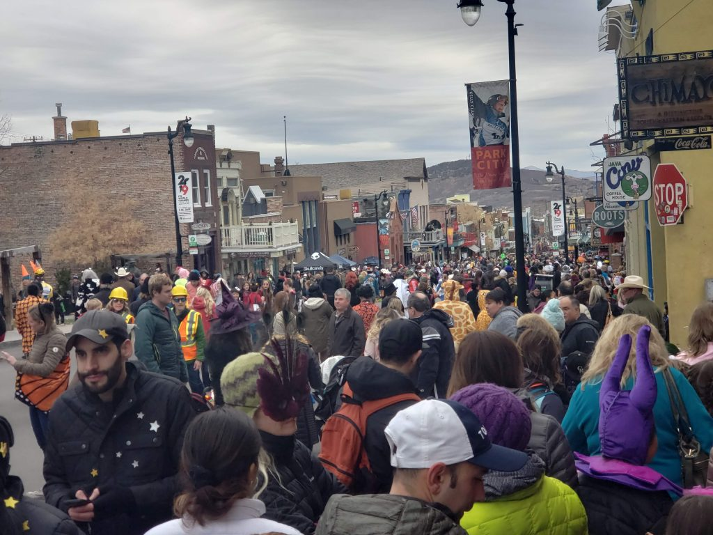 crowds of costumed trick-or-treaters pack Park City's Main Street on Halloween