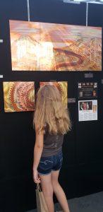 Girl Browsing Art