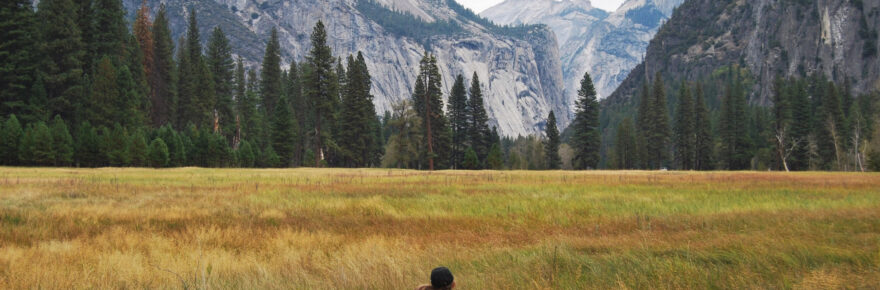 Couple looking at landscape in Yosemite National Park in the Yosemite Valley, California. Photo by Anneliese Phillips